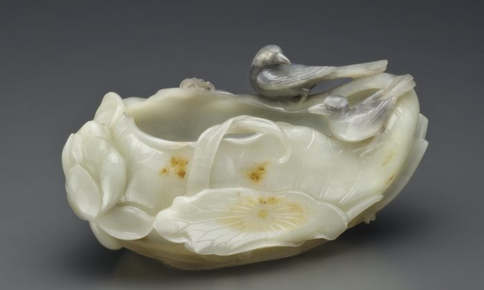 A Finely Carved Black and White Jade Lotus-Form Brush Washer 17th/18th century. Sold, September 2013, for $543,750. (Courtesy of Christie's)