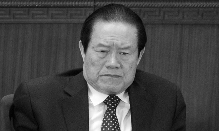 Zhou Yongkang, former member of the Politburo Standing Committee, attends the opening session of the National People's Congress (NPC) in Beijing on March 5, 2012. Zhou is in the middle of a political downfall, with high-profile revelations of corruption leveled against his family in the press. (Liu Jin/AFP/Getty Images)