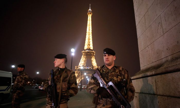 French soldiers stand guard near the Eiffel Tower in Paris on March 30, 2013. (Thomas Coex/AFP/Getty Images)