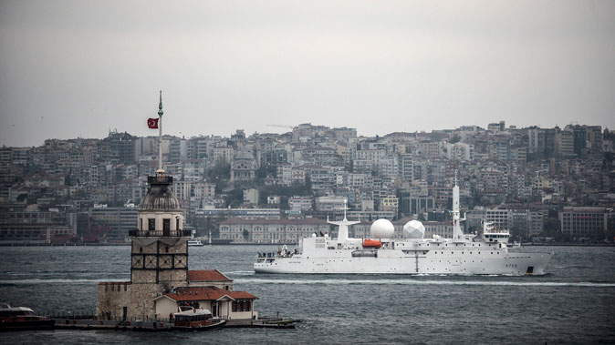 French intelligence warship Dupuy-de-Lome sails through the Boshporus in Istanbul, Turkey, on April 10, 2014, en route to the Black Sea. The United States sent warship USS Donald Cook to the Black Sea in order to reassure European allies in the region following Russia's annexation of Crimea. Pentagon spokesman colonel Steven Warren insisted the deployment of the Donald Cook was meant only to reassure regional allies. The Maiden's Tower is at the left. (Bulent Kilic/AFP/Getty Images)