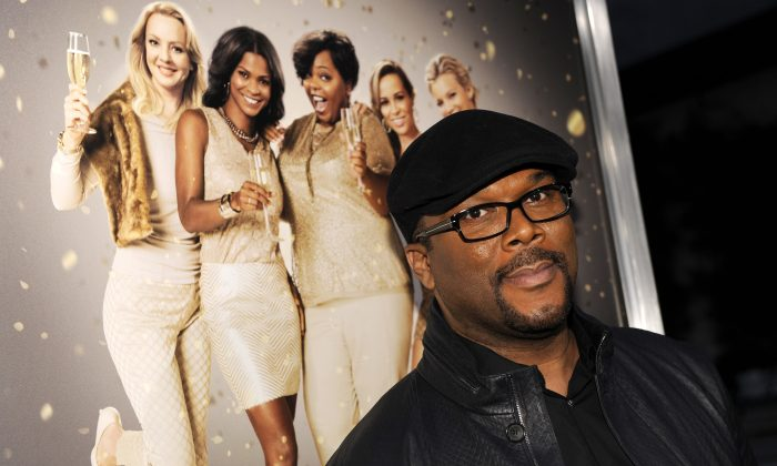 """Tyler Perry arrives at the world premiere of """"The Single Moms Club"""" in Los Angeles on March 10, 2014. (Chris Pizzello/Invision/AP)"""