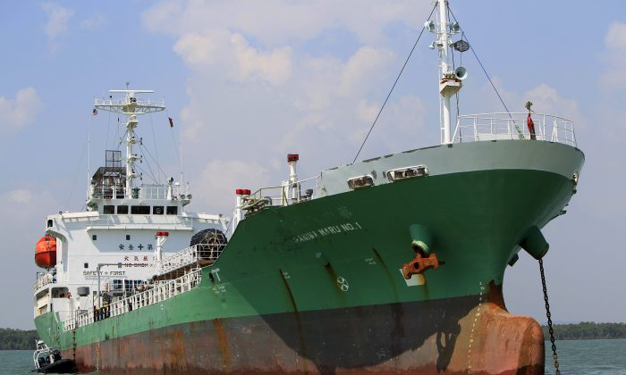 Singapore-owned tanker Naniwa Maru 1 is anchored at Klang port, Malaysia, Wednesday, April 23, 2014 after being robbed by pirates. (AP Photo/Lai Seng Sin)