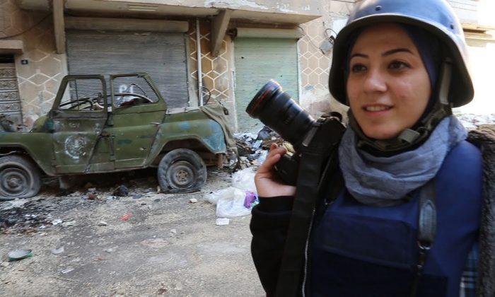 "Syrian teacher-turned-war-photographer Nour Kelze in Matthew VanDyke's short documentary ""Not Anymore: a Story of Revolution."" (Courtesy of Not Anymore)"