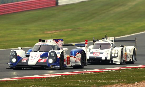 The #8 Toyota TS040 Hybrid leads the #20 Porsche 919 Hybrid during the WEC Six Hours of Silverstone, April 20, 2014. (toyotahybridracing.com)