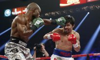 Manny Pacquiao 'Cheated In Rematch Fight Against Timothy Bradley With Plaster Hidden In His Gloves' is Fake