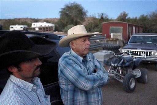 Cliven Bundy, right, and Clance Cox, left, stand at the Bundy ranch near Bunkerville Nev. Saturday, April 5, 2014. (AP Photo/Las Vegas Review-Journal, John Locher)