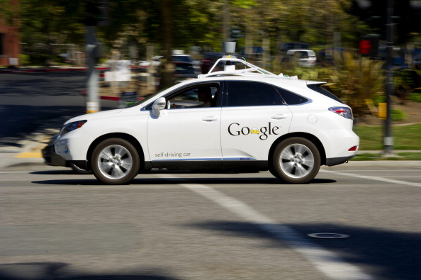 A man drives a Google Inc. self-driving car in front of the company's headquarters in Mountain View, California. (David Paul Morris/Bloomberg via Getty Images)