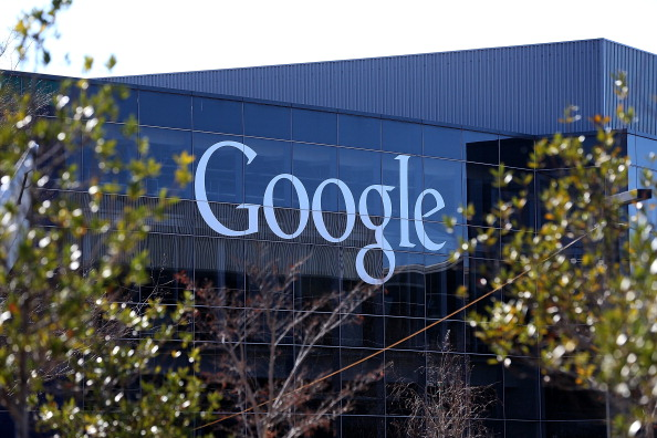 A sign is posted on the exterior of Google headquarters in Mountain View, Calif. Google exposed a cyberattack launched under the authority of CNNIC, one of the Chinese regime's main Internet authorities. (Justin Sullivan/Getty Images)
