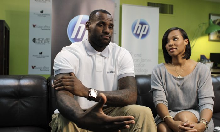 Miami Heat basketball player LeBron James and his then-girlfriend Savannah Brinson at the Northwest Boys & Girls Club in Miami, Wednesday, March 2, 2011. The LeBron James Family Foundation partnered with HP to donate 1,000 computers nationwide to Boys & Girls Clubs of America. (AP Photo/Lynne Sladky)