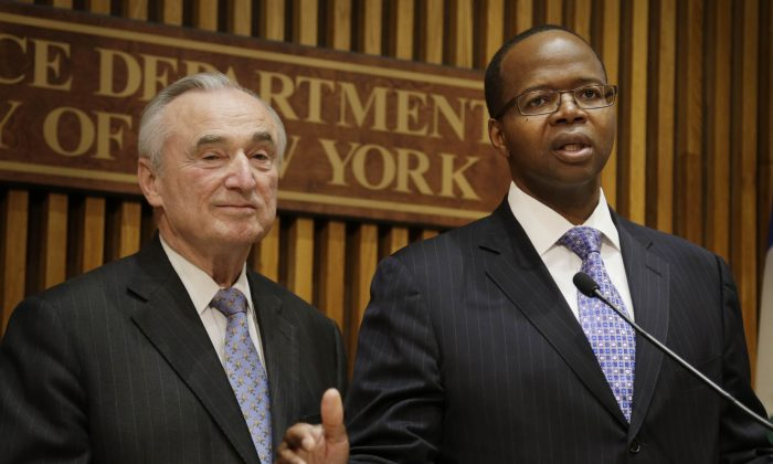 New York City Police Commissioner Bill Bratton, left, and Brooklyn District Attorney Kenneth Thompson speak to reporters during a news conference at police headquarters in New York, Wednesday, April 30, 2014. (AP Photo/Seth Wenig)