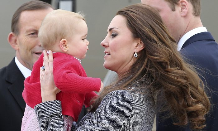 Kate the Duchess of Cambridge holds Prince George as they say  goodbye before they board their flight in Canberra,  Australia, Friday, April 25, 2014. (AP Photo/Rob Griffith)