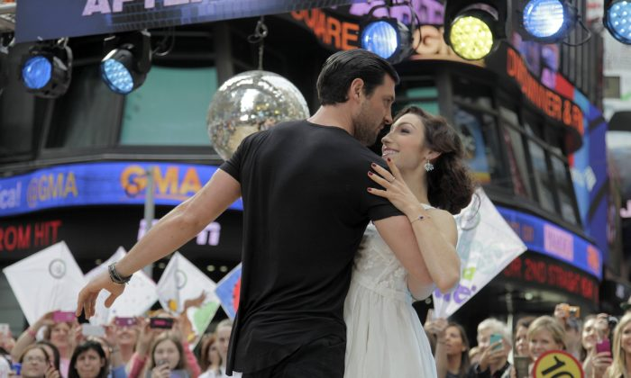 "Olympic athlete Meryl Davis, right, and dancer Maksim Chmerkovskiy, winners of ""Dancing with the Stars"" , appear on ABC's Good Morning America on Wednesday, May 21, 2014, in New York. (Andy Kropa/Invision/AP)"