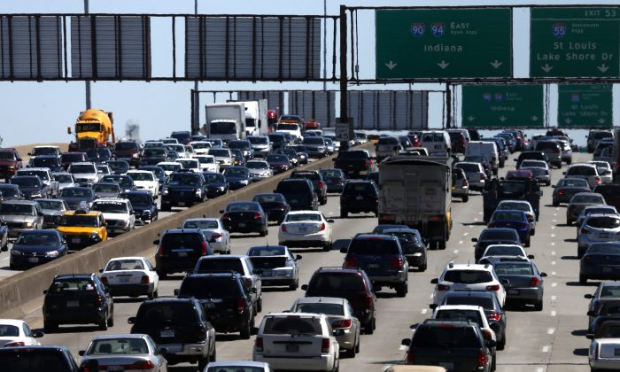 FILE - In this May 24, 2013 file photo, traffic begins to thicken as motorists getting an early jump to Memorial Day destinations in Indiana and Michigan travel an interstate freeway through Chicago. Auto club AAA on Friday, May 16, 2014 said it expects a total of 36.1 million people to travel 50 miles or more this Memorial Day Weekend. If that estimate holds true, it would be the largest amount of people traveling during the holiday weekend since 2005. (AP Photo/Charles Rex Arbogast, File)