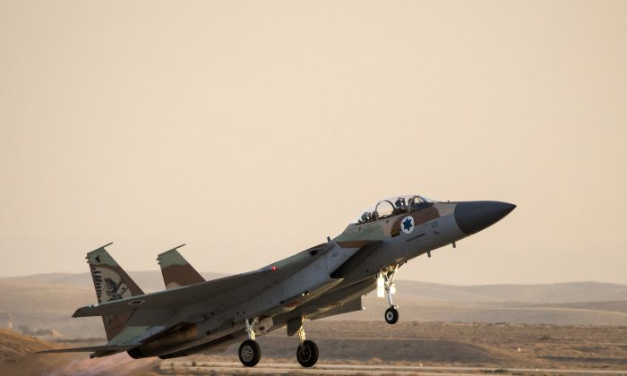 An Israeli F-15 I fighter jet takes off during an air show at the graduation ceremony of Israeli air force pilots at the Hatzerim base in the Negev desert, near the southern Israeli city of Beersheva on December 26, 2013. (Jack Guez/AFP/Getty Images)