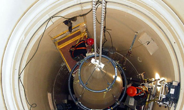 """In this image released by the U.S. Air Force, a Malmstrom Air Force Base missile maintenance team removes the upper section of an ICBM at a Montana missile site. An Air Force security team's botched response to a simulated assault on a nuclear missile silo has prompted a blistering review followed by expanded training to deal with the nightmare scenario of a real attack. But an internal review of the exercise held last summer at Malmstrom Air Force Base in Montana said the security forces were unable to speedily regain control of the captured silo, and called this a """"critical deficiency."""" The Associated Press obtained a copy of the report through a Freedom of Information Act request. (AP Photo/U.S. Air Force, John Parie)"""
