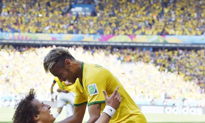 Brazil's David Luiz, left, and Neymar celebrate after Brazil's opening goal during the World Cup round of 16 soccer match between Brazil and Chile at the Mineirao Stadium in Belo Horizonte, Brazil, Saturday, June 28, 2014. (AP Photo/Martin Meissner)