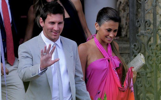 Barcelona's foward Lionel Messi and his girlfriend Antonella Roccuzzo arrive for the wedding ceremony of Spain's midfielder Andres Iniesta in Altafulla, near Tarragona on July 8, 2012. (JOSEP LAGO/AFP/GettyImages)