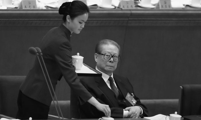 Former Chinese Communist Party Jiang Zemin (R) attends the opening session of the 18th Communist Party Congress held at the Great Hall of the People on Nov. 8, 2012 in Beijing, China. Rumors of Jiang and his mistresses have been passed around on Chinese internet unhampered, in contravention to custom. (Feng Li/Getty Images)