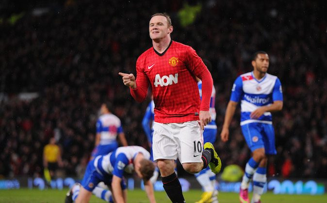 Wayne Rooney of Manchester United celebrates scoring the opening goal during the Barclays Premier League match between Manchester United and Reading at Old Trafford on March 16, 2013 in Manchester, England. (Michael Regan/Getty Images)