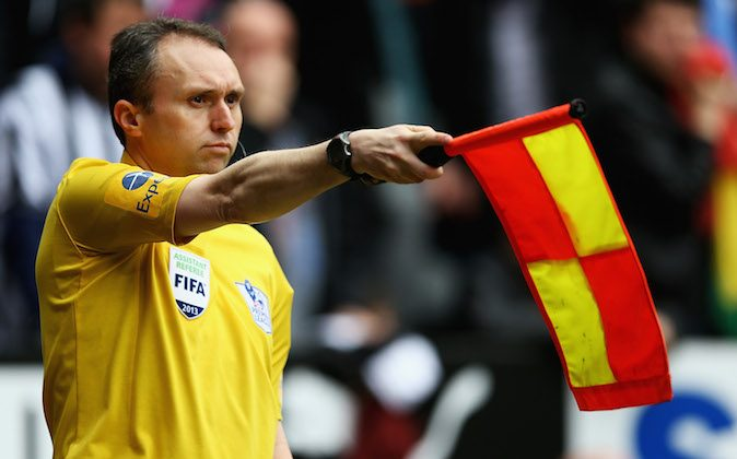 Assistant referee D Cann, awards Papiss Demba Cisse of Newcastle United offside during the Barclays Premier League match between Newcastle United and Sunderland at St James' Park on April 14, 2013 in Newcastle upon Tyne, England. (Matthew Lewis/Getty Images)