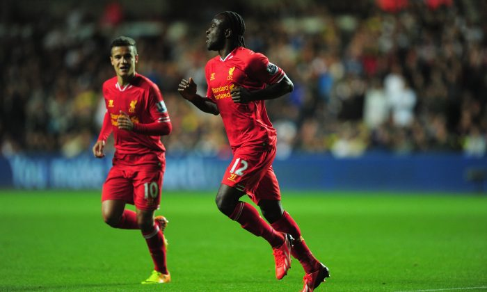 Liverpool striker Victor Moses (r) celebrates after scoring the second Liverpool goal during the Barclays Premier League match between Swansea City and Liverpool at Liberty Stadium on September 16, 2013 in Swansea, Wales. (Photo by Stu Forster/Getty Images)