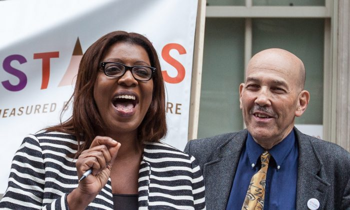 Public Advocate Letitia James (L) and former test specialist Fred Smith at a press conference on Tweed Hall steps, in Manhattan, Wednesday, June 11, 2014. (Petr Svab/Epoch Times)