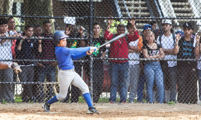 A batter hits the ball during the Small Schools Athletic League's last game of the season, Saint Mary's Park, the Bronx, June 13. (Petr Svab/Epoch Times)