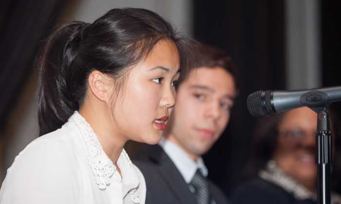 Jessie Wang, student member of the Panel for Educational Policy, speaks at the panel meeting in Bronx, June 24, 2014. (Petr Svab/Epoch Times)