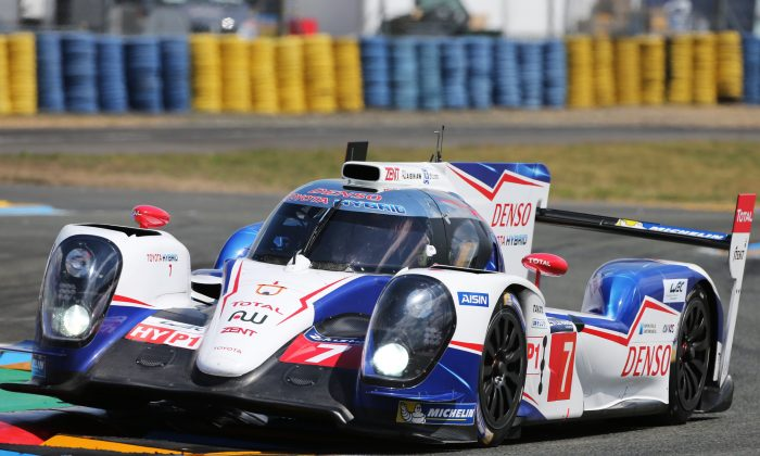 The #7 Toyota TS 040 leads the 82nd Le Mans 24-hour race after eight hours at the Circuit de la Sarthe at Le Mans, France, June14-15, 2014. (ToyoaHybridRacing.com)