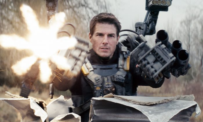 """This image released by Warner Bros. Pictures shows Tom Cruise in a scene from """"Edge of Tomorrow."""" (AP Photo/Warner Bros. Pictures)"""