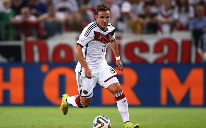 Mario Goetze of Germany runs with the ball during the International Friendly match between Germany and Armenia at Coface Arena on June 6, 2014 in Mainz, Germany. (Photo by Simon Hofmann/Bongarts/Getty Images)