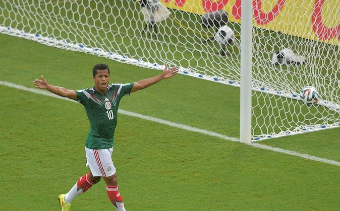 Mexico's forward Giovani Dos Santos reacts after his goal was disallowed during the Group A football match between Mexico and Cameroon at the Dunas Arena in Natal during the 2014 FIFA World Cup on June 13, 2014. (GABRIEL BOUYS/AFP/Getty Images)