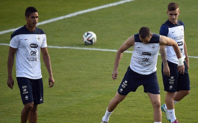 France's defender Raphael Varane, forward Karim Benzema and forward Antoine Griezmann take part in a training session at the Santa Cruz Stadium in Ribeirao Preto on June 13, 2014, during the 2014 FIFA World Cup in Brazil. (FRANCK FIFE/AFP/Getty Images)