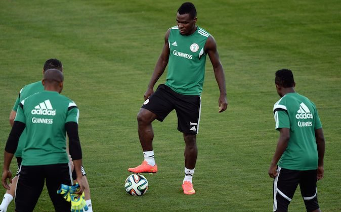 Nigeria's forward Emmanuel Emenike (C) warms up with teammates during a training session in Campinas on June 13, 2014 during the 2014 FIFA World Cup tournament in Brazil. (JEWEL SAMAD/AFP/Getty Images)