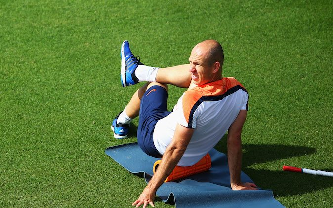 Arjen Robben stretches during the Netherlands training session at the 2014 FIFA World Cup Brazil held at the Estadio Jose Bastos Padilha Gavea on June 14, 2014 in Rio de Janeiro, Brazil. (Dean Mouhtaropoulos/Getty Images)