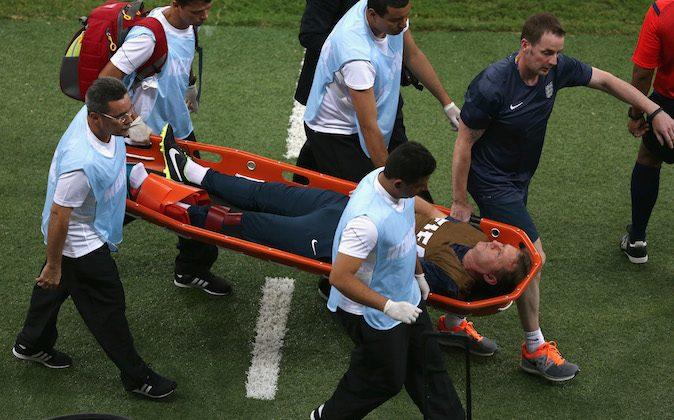 "England trainer Gary Lewin is stretchered off the field after a leg injury during the 2014 FIFA World Cup Brazil Group D match between England and Italy at Arena Amazonia on June 14, 2014 in Manaus, Brazil. (Photo by Warren Little/Getty Images)  England coach Roy Hodgson says ""that was a very sad moment for us. In celebrating the goal he jumped up, landed on a water bottle and dislocated his ankle."""