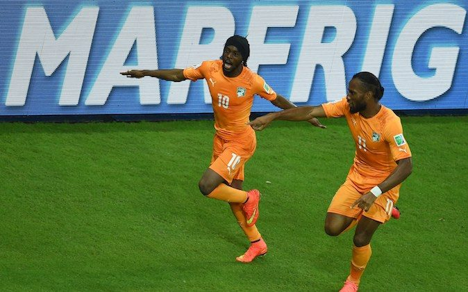 Ivory Coast's forward Gervinho (L) celebrates with Ivory Coast's forward and captain Didier Drogba after scoring during a Group C football match between Ivory Coast and Japan at the Pernambuco Arena in Recife during the 2014 FIFA World Cup on June 14, 2014. (EMMANUEL DUNAND/AFP/Getty Images)