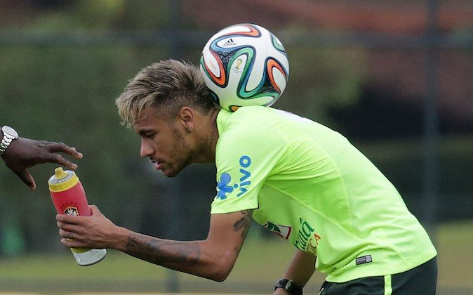 Brazilian national football team player Neymar takes part in a training session at the squad's Granja Comary training complex in Teresopolis, Brazil on June 15, 2014. (ARI VERSIANI/AFP/Getty Images)