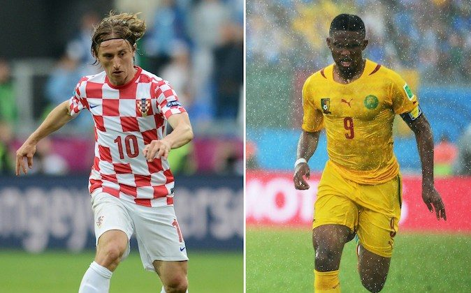 Croatian midfielder Luka Modric (L) and Cameroon forward Samuel Eto'o. Cameroon and Croatia clash in Manaus on June 18, 2014 looking to put their troubles behind them and keep alive their hopes of making the World Cup knock-out rounds. (FRANCISCO LEONG/AFP/Getty Images)
