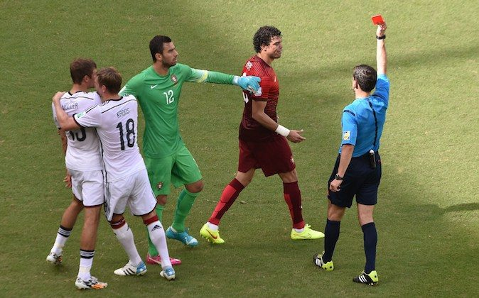 Portugal's defender Pepe (2nd R) receives the red card from Serbian referee Milorad Mazic (R) during the Group G football match between Germany and Portugal at the Fonte Nova Arena in Salvador during the 2014 FIFA World Cup on June 16, 2014. (DIMITAR DILKOFF/AFP/Getty Images)