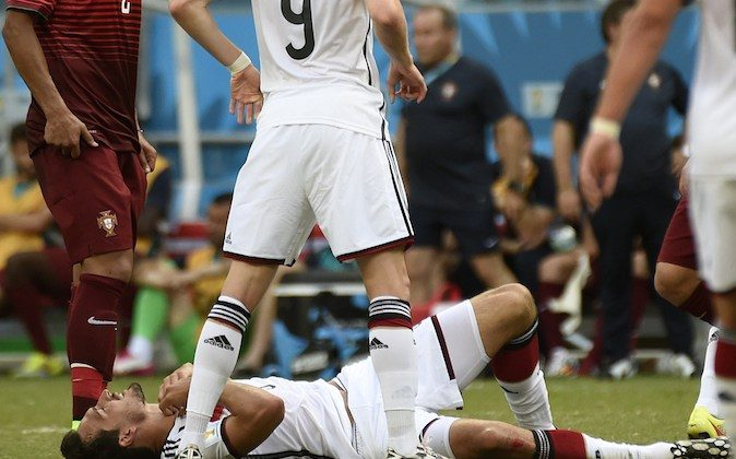 Germany's defender Mats Hummels is injured during the Group G football match between Germany and Portugal at the Fonte Nova Arena in Salvador during the 2014 FIFA World Cup on June 16, 2014. (ODD ANDERSEN/AFP/Getty Images)