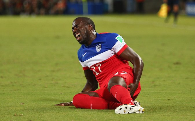 An injured Jozy Altidore of the United States lies on the field during the 2014 FIFA World Cup Brazil Group G match between Ghana and the United States at Estadio das Dunas on June 16, 2014 in Natal, Brazil. (Michael Steele/Getty Images)