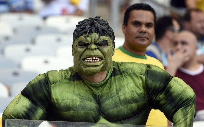 A fan dressed as fictional superhero Hulk cheers prior to a Group H football match between Belgium and Algeria at the Mineirao Stadium in Belo Horizonte during the 2014 FIFA World Cup on June 17, 2014. (MARTIN BUREAU/AFP/Getty Images)