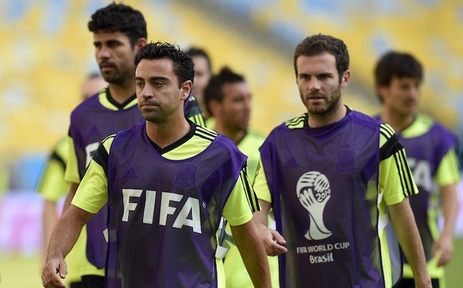 Spain's midfielder Xavi (C) attends a training session with teammates at the Maracana Stadium in Rio de Janeiro during the 2014 FIFA World Cup football tournament on June 17, 2014. (LLUIS GENE/AFP/Getty Images)