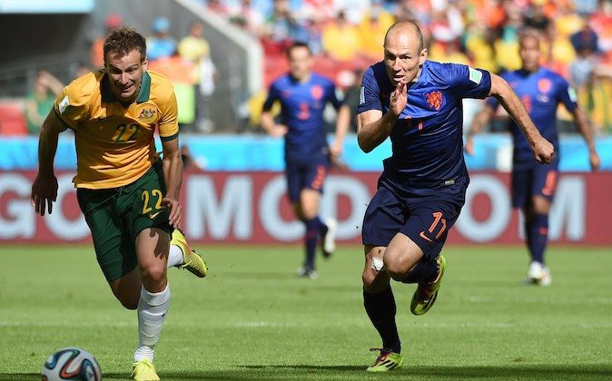 Netherlands' forward Arjen Robben (R) vies with Australia's defender Alex Wilkinson during a Group B football match between Australia and the Netherlands at the Beira-Rio Stadium in Porto Alegre during the 2014 FIFA World Cup on June 18, 2014. (WILLIAM WEST/AFP/Getty Images)