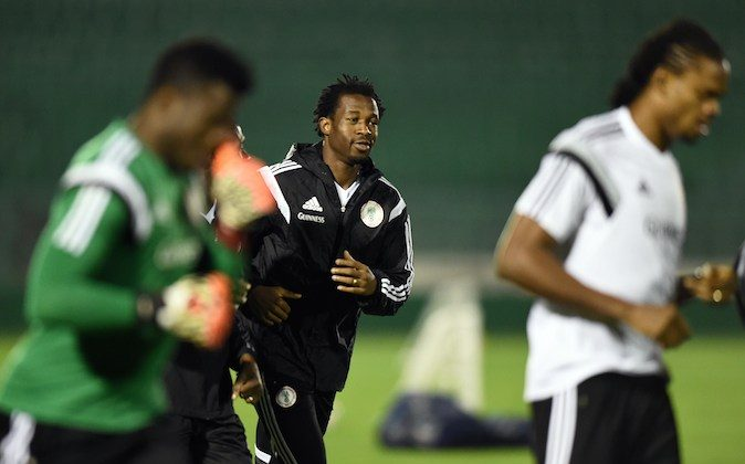 Nigeria's defender Efe Ambrose (C) jogs with his team during a training session in Campinas, Sao Paulo, on June 18, 2014, during the 2014 FIFA Football World Cup. (JEWEL SAMAD/AFP/Getty Images)