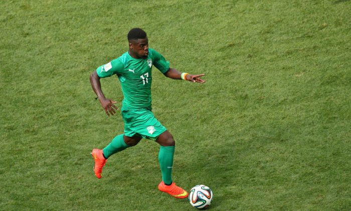 Serge Aurier of the Ivory Coast controls the ball during the 2014 FIFA World Cup Brazil Group C match between Colombia and Cote D'Ivoire at Estadio Nacional on June 19, 2014 in Brasilia, Brazil. (Adam Pretty/Getty Images)