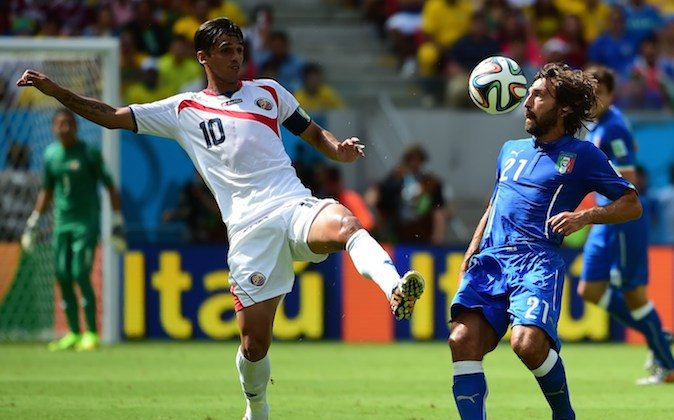 Italy's midfielder Andrea Pirlo (R) and Costa Rica's forward Bryan Ruiz (L) vie for the ball during a Group D football match between Italy and Costa Rica at the Pernambuco Arena in Recife during the 2014 FIFA World Cup on June 20, 2014. (RONALDO SCHEMIDT/AFP/Getty Images)
