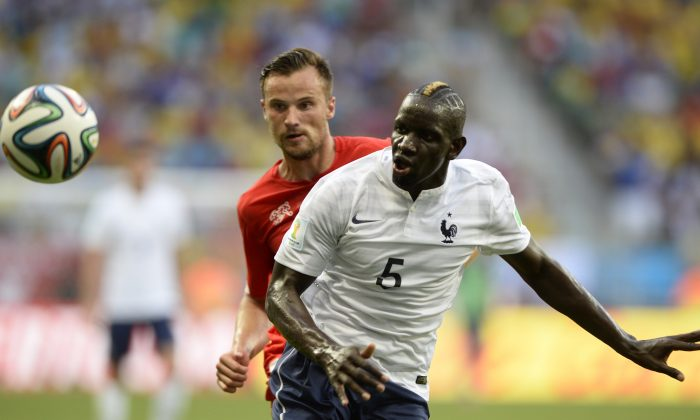 France's defender Mamadou Sakho (R) vies with Switzerland's forward Haris Seferovic during a Group E football match between Switzerland and France at the Fonte Nova Arena in Salvador during the 2014 FIFA World Cup on June 20, 2014. (FRANCK FIFE/AFP/Getty Images)