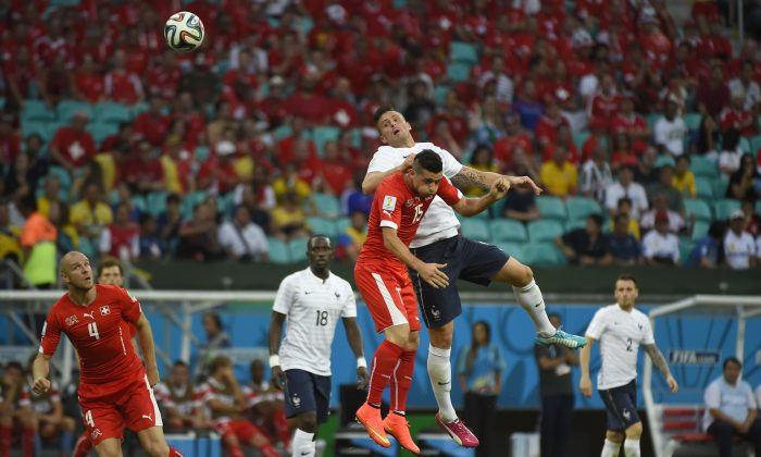 France's forward Olivier Giroud (top R) heads the ball past Switzerland's midfielder Blerim Dzemaili (top L) during a Group E football match between Switzerland and France at the Fonte Nova Arena in Salvador during the 2014 FIFA World Cup on June 20, 2014. (ODD ANDERSEN/AFP/Getty Images)